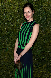 A boxy chain-strap purse added an elegant pop of gold to Hilary Rhoda's sporty stripes during the United Nations World Food Programme dinner.