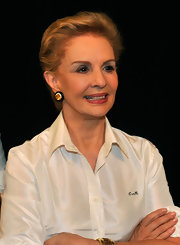 Carolina Herrera sported her usual short 'do during her Spring 2012 show.
