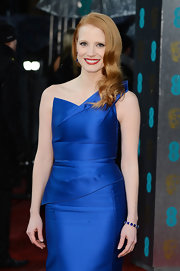 Jessica Chastain donned a Harry Winston sapphire and diamond bracelet to match her blue gown at the BAFTAs.