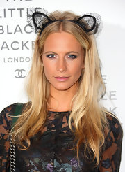 Poppy Delevingne topped off her look in quirky style with a lacy cat-ear headband.
