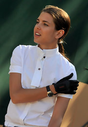 Charlotte Casiraghi wore a stylish leather-band quartz watch at the 2010 Global Champions Tour.