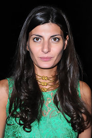 Giovanna Battaglia looked very feminine at the YSL fashion show wearing her hair loose with curly ends.