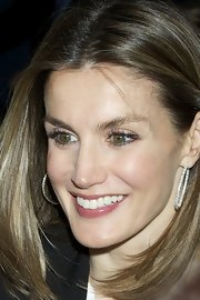 Princess Letizia dolled up her look with a pair of gorgeous diamond hoops when she attended the STELA Business Club Dinner.