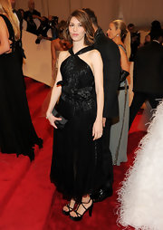 Sofia Coppola complemented her dress with a pair of strappy black platform sandals.