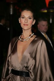 Celine Dion paired a broad black leather belt with a gold dress for the 2007 Vanity Fair Oscar party.