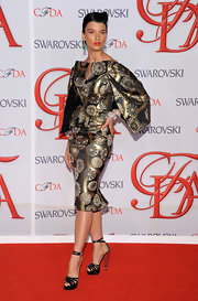 Crystal Renn polished off her look with strappy black platforms.