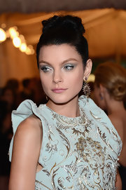 Jessica Stam styled her raven hair into a twisted bun for the Met Gala.