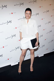 Garance Dore was casual and cool in a loose white blouse at the Maison Jules presentation.