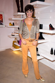 Ines de la Fressange pulled off an orange tank and pants team-up with a silver jacket at the Roger Vivier cocktail party.