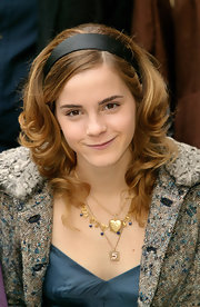Emma Watson added an extra dose of sweetness with a gold heart pendant.