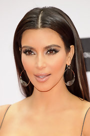 Kim Kardashian paired her 'do with sterling hoops for a chicer finish.