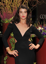 Crystal Renn styled her black dress with a pair of gold bracelets for the New Yorkers for Children Spring Dinner Dance.