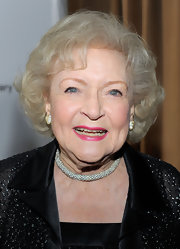 Betty White looked stylish with her curly bob at the 'Hot in Cleveland' premiere party.