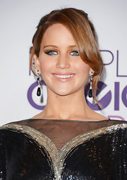 Jennifer Lawrence sported a sexy updo with side-swept bangs when she attended the People's Choice Awards.