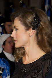 Princess Letizia pinned her curls back with a beaded black clip that echoed the style of her dress.