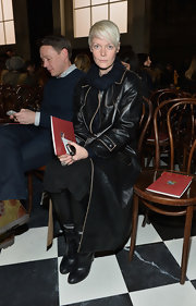 Kate Lanphear was tough-chic in a black leather coat with beige trim during the Tommy Hilfiger fashion show.