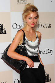 Imogen Poots arrived for the New York premiere of 'One Day' carrying a stylish black leather bag.