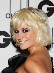 Pixie Lott channeled the '80s with some lavender eyeshadow.
