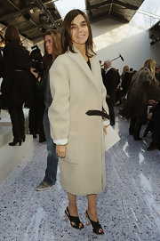Carine Roitfeld styled her coat with a pair of plexi-heeled cross-strap sandals.