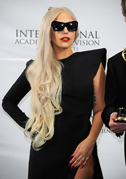 Lady Gaga attended the 39th International Emmy Awards rocking red and black nail art.