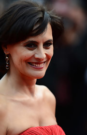 Ines de la Fressange wore triple gemstone dangle earrings at the premiere of 'Jeune et Jolie.'