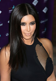 Kim Kardashian wore her hair pin-straight with a center part during the launch of QuickTrim.