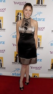 Anna Kendrick opted for a pair of black peep-toes to team with her dress.