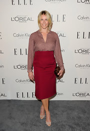Chelsea Handler accented her secretary chic attire with a wine red box clutch.