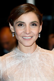 Clotilde Courau kept it classic with a pair of dangling diamond earrings at the Cannes Film Festival premiere of 'Les Salauds.'
