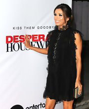 Eva Longoria paired a two-tone box clutch with a ruffle LBD for the 'Desperate Housewives' final season kickoff party.