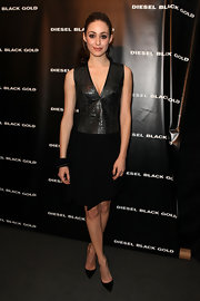 Emmy Rossum was edgy-sophisticated in a crocodile-bodice LBD during the Diesel Black Gold fashion show.