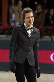Charlotte Casiraghi accessorized with a pair of black leather gloves.