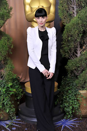 Rooney Mara chose a black wide-leg jumpsuit with a ruffled neckline for the Academy Awards nominations luncheon.