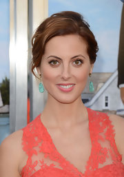 These statement turquoise earrings provided a lovely pop of contrasting colour to Eva's bold orange dress.