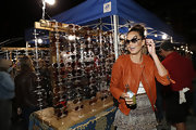 Chrissy Teigen went to the Le Grand Fooding NY Campfire Session Food & Music Festival looking smart in a rust-colored leather jacket.