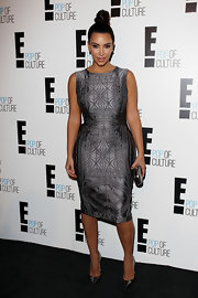 Kim Kardashian stood out in an ornately embroidered silver cocktail dress by Vera Wang at the E! Channel Brand Evolution event.