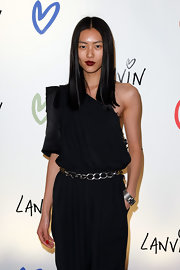 Liu Wen styled her one-shoulder jumpsuit with a silver chain belt for the Lanvin Halloween Extravaganza.