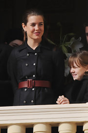 Charlotte Casiraghi paired a broad red belt with a black jacket for Monaco National Day 2009.