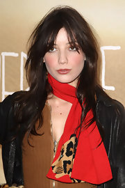 Daisy Lowe added a vibrant touch to her look with a red tiger-print scarf.