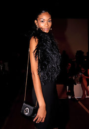 Chanel Iman cut a glamorous figure at the Gucci party with this satin shoulder bag and feathered LBD combo, both by the Italian fashion house.