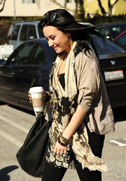 Demi Lovato styled her outfit with a patterned scarf for a day out in Santa Monica.