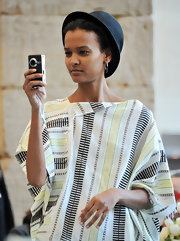 Liya Kebede looked cute wearing a Chaplin hat at the Tribute to the Models of Versailles 1973 event.