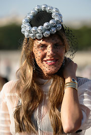Anna dello Russo looked zany in a disco ball hat during the Christian Dior fashion show.