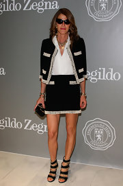 Anna dello Russo looked very classy in a pearl-trimmed black skirt suit during the Ermenegildo Zegna exhibition.