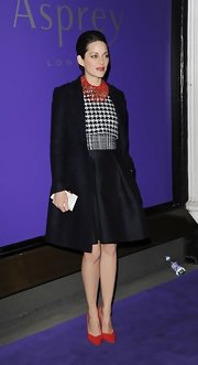 Marion Cotillard looked perfectly put together in a black wool coat, a houndstooth dress, and red accessories during the EE British Academy Film Awards nominees party.