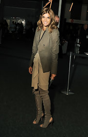 Carine Roitfeld finished off her look in fierce style with over-the-knee taupe lace-up boots.