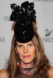 Anna dello Russo also wore a pair of dangling spheres to match her necklace.