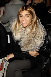 Carine Roitfeld looked warm and chic in her thick fur scarf during the BCBG Max Azria fashion show.