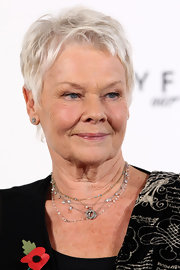 Judi Dench attended the photocall for 'Skyfall' wearing her trademark pixie cut.