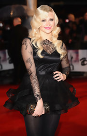 Pixie Lott paired black nail polish with a lacy LBD for a totally vampy look.
